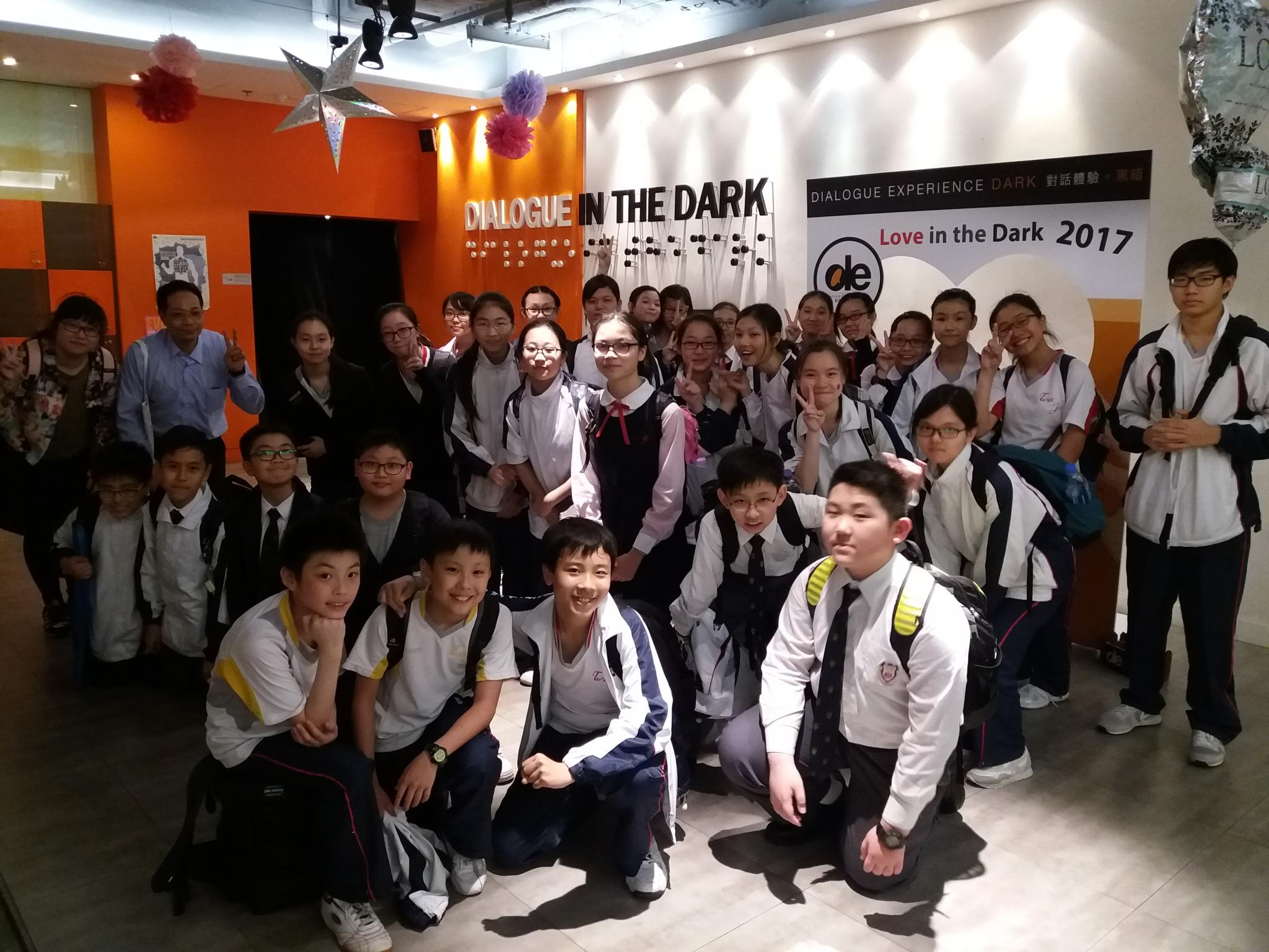 Our teachers and students took a group photo at the entry of Dialogue in the Dark  Exhibition Centre