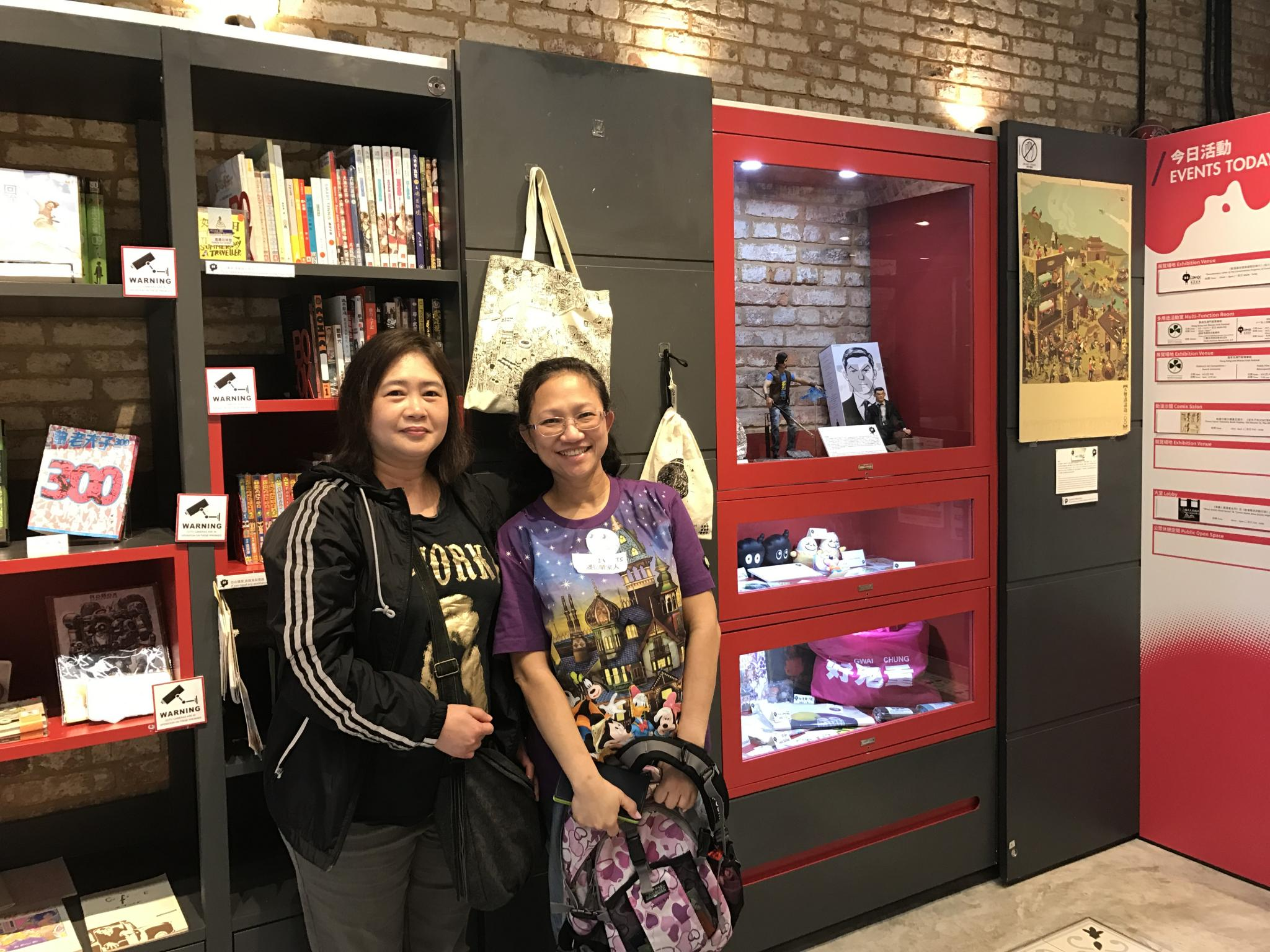The participants are visiting the Comix Home Base in Wan Chai.