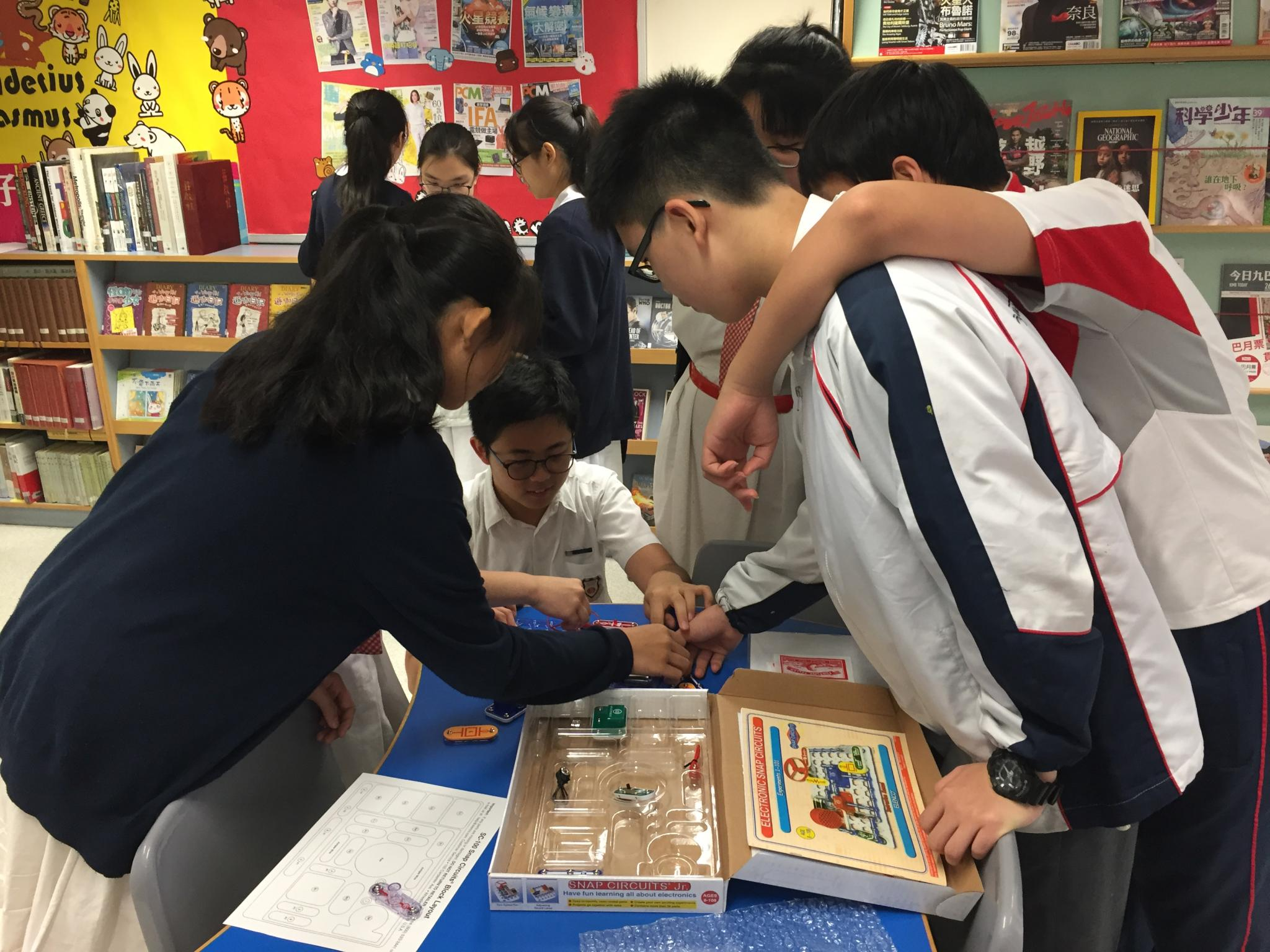 Students were playing the Electronics Discovery Kit together.