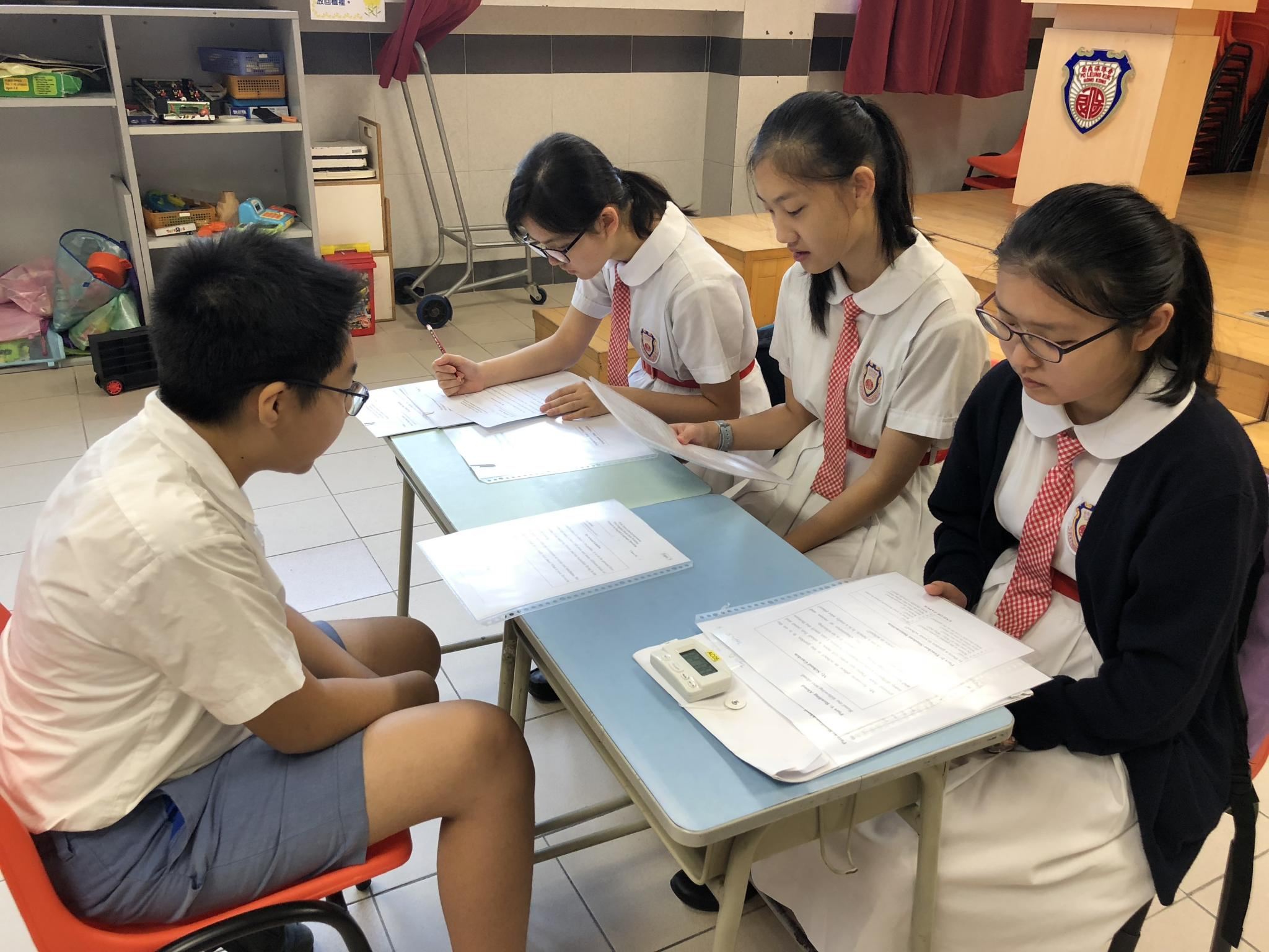 Our students were the examiners to assess the Primary 6 students.