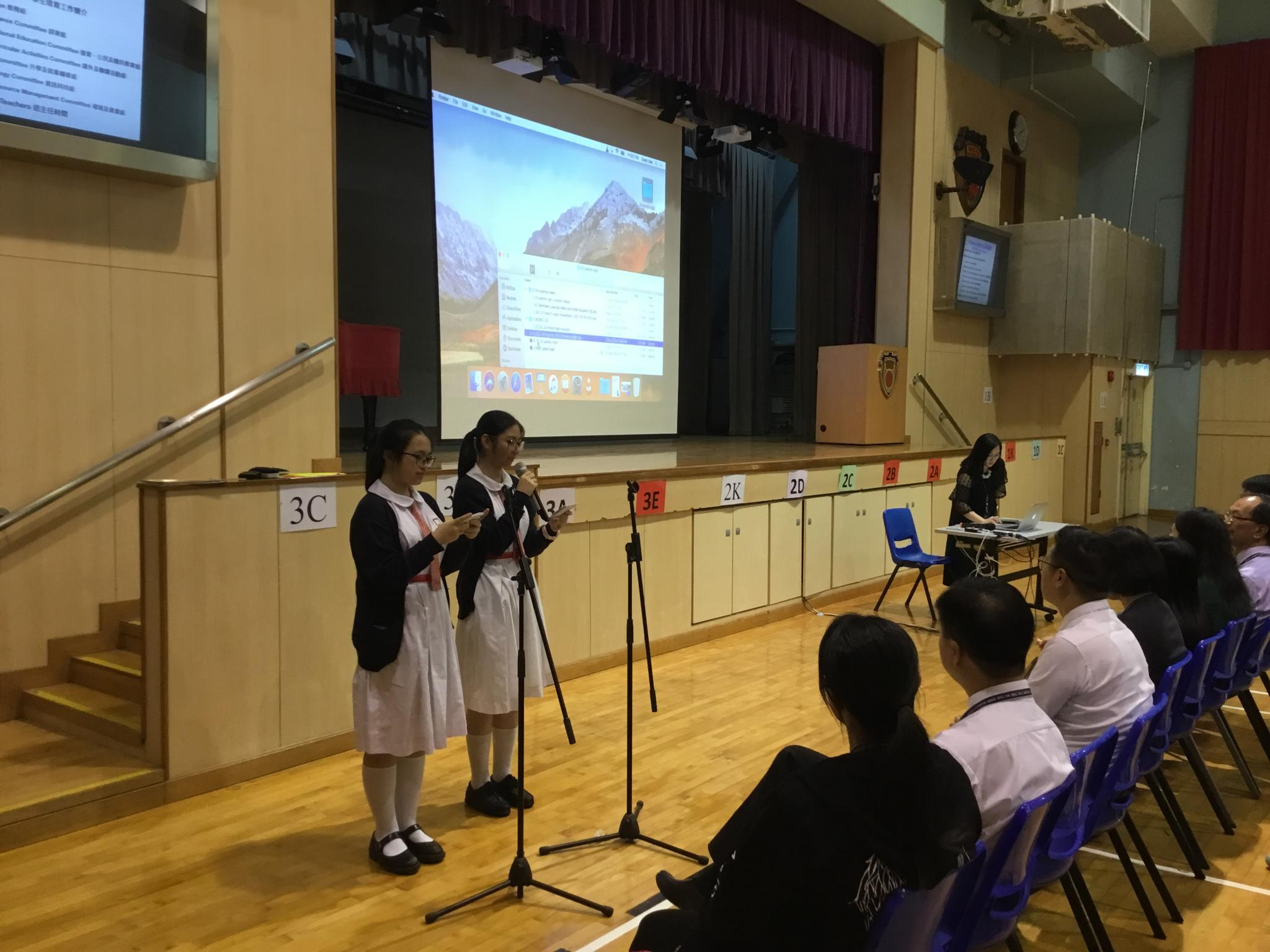 Student MCs introduce the committee heads.