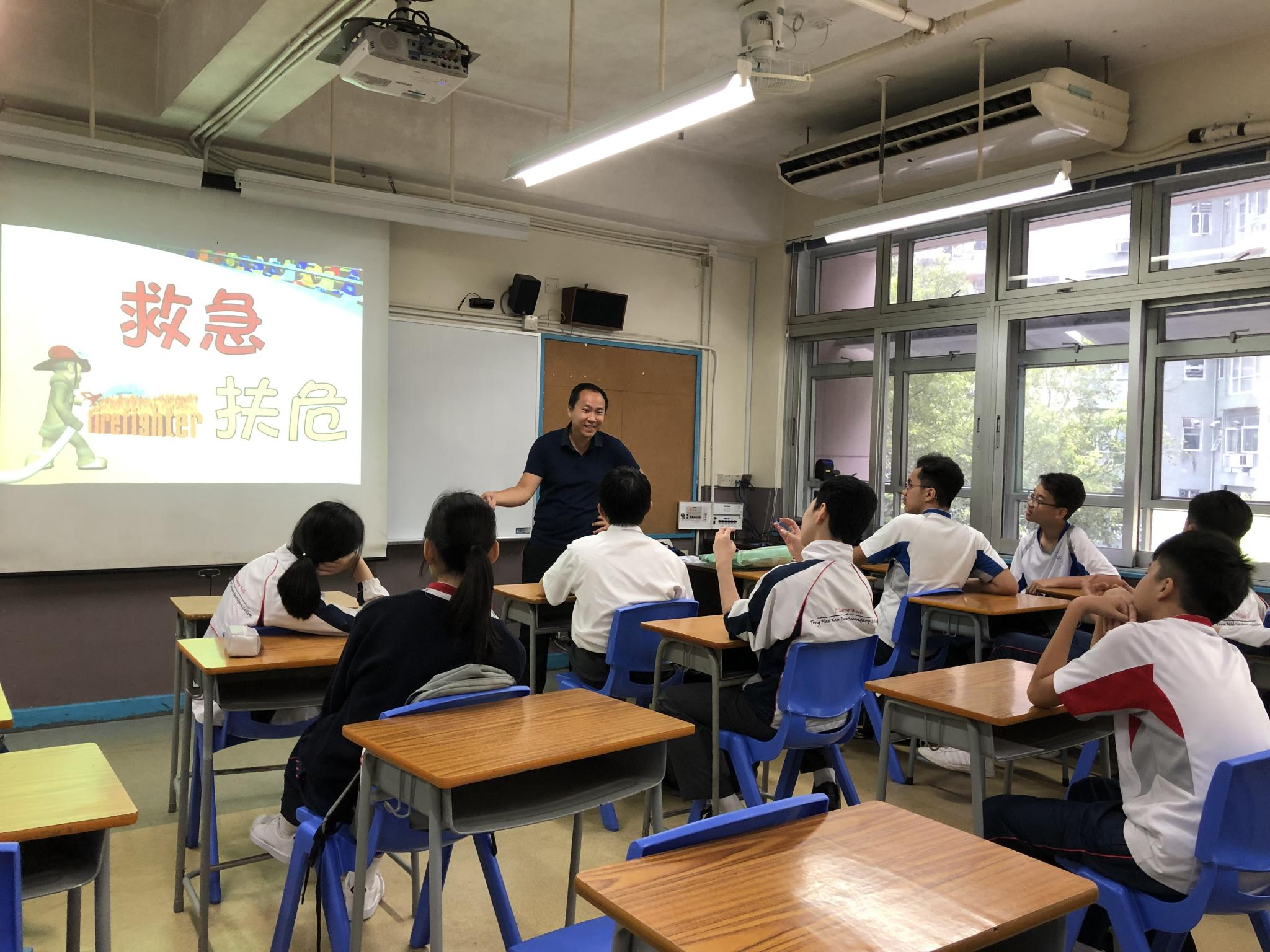 Students were listening to the tutor's introduction about a fireman.