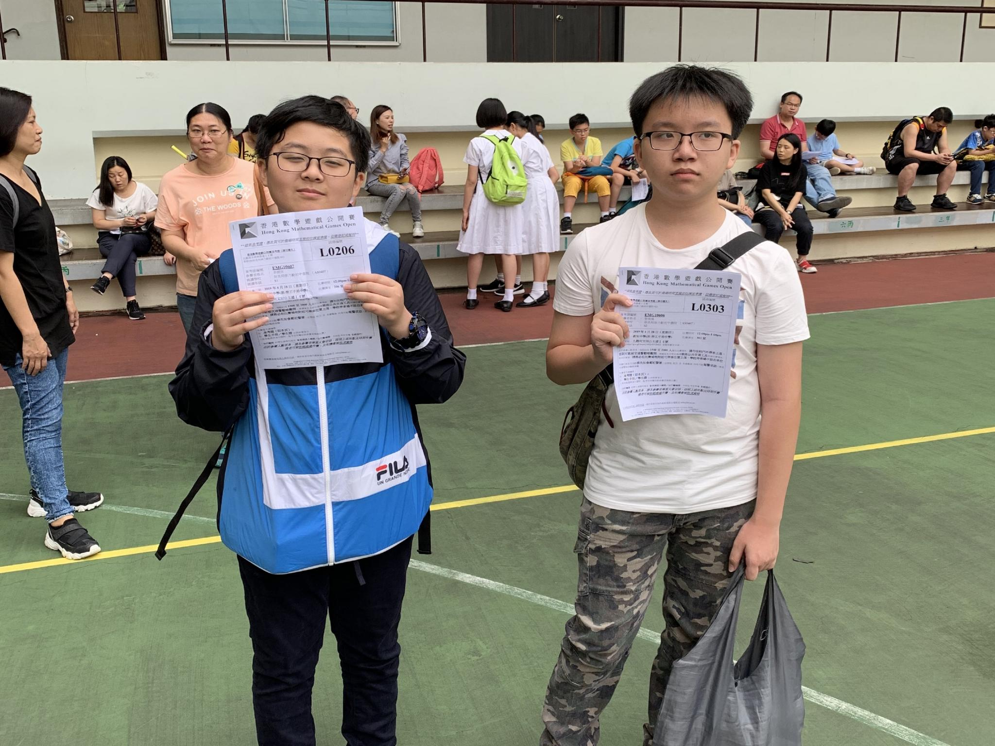 The two students compete with each other to win the game.