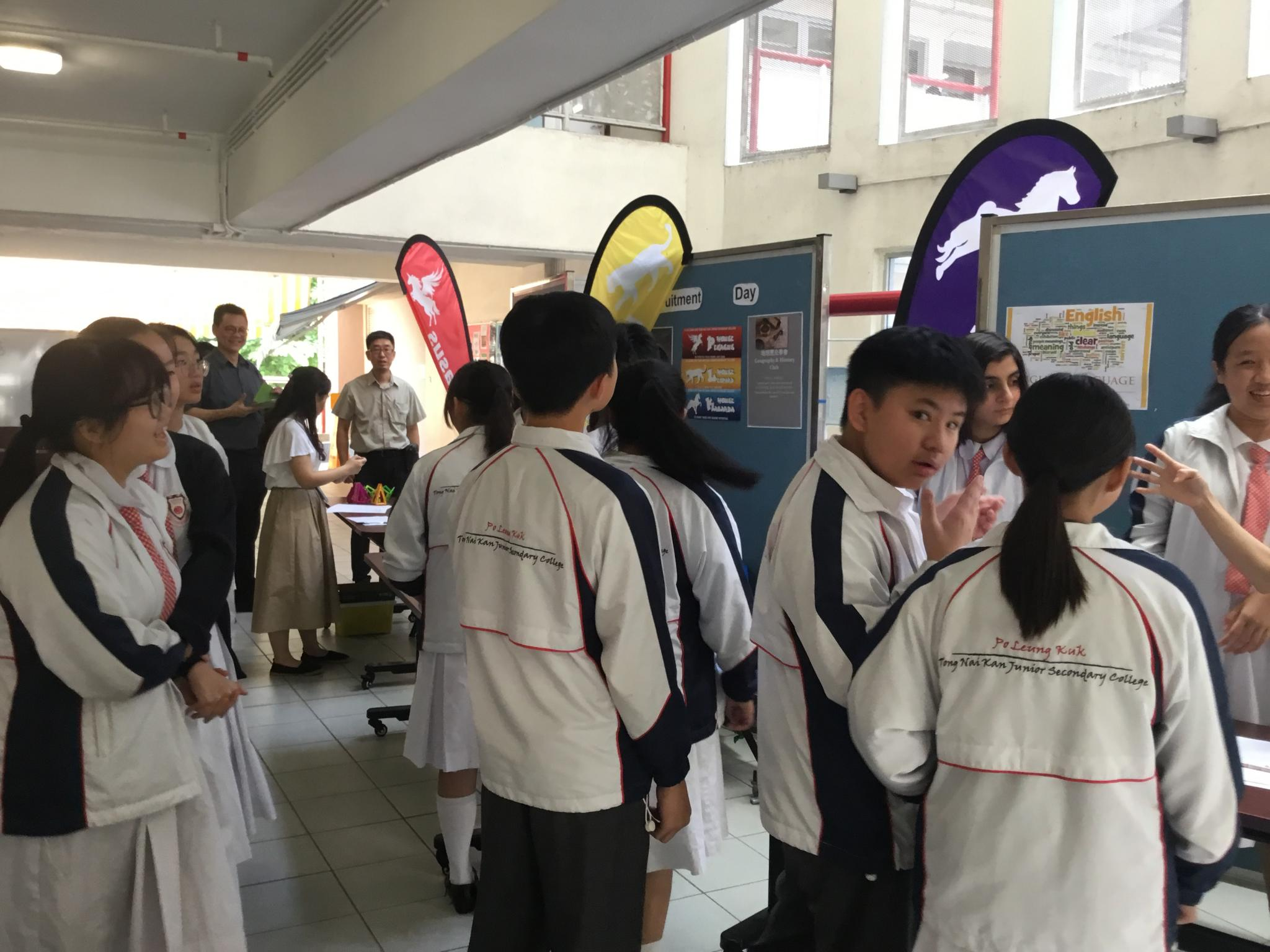 Students were enrolling different academic clubs during the recess outside the school hall.