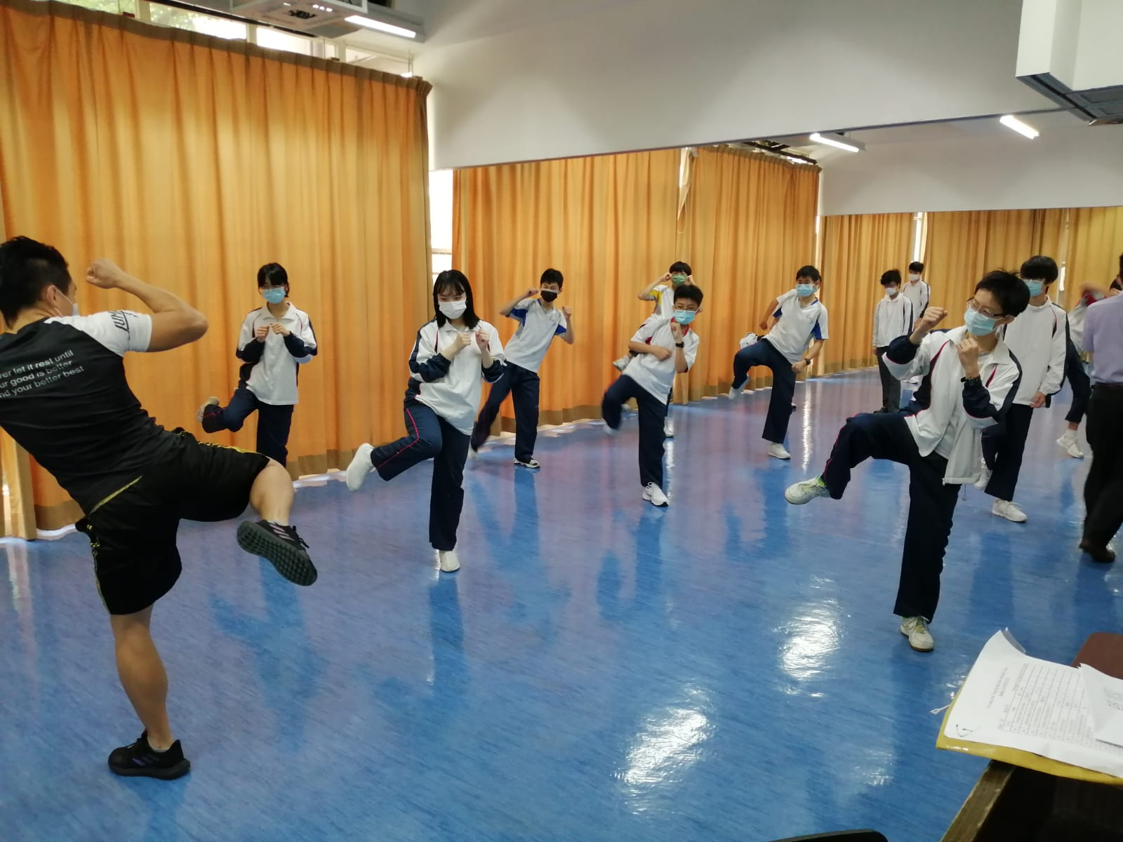 Mr. Li is teaching our students some simple Thai boxing techniques.